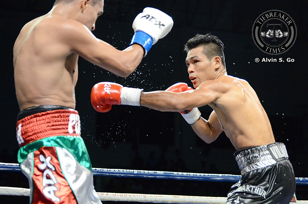 Philippine Sports News - Tiebreaker Times Arthur Villanueva scores 4th round knockdown, but succumbs to WBC champion Boxing News  Arthur Villanueva ALA Promotions
