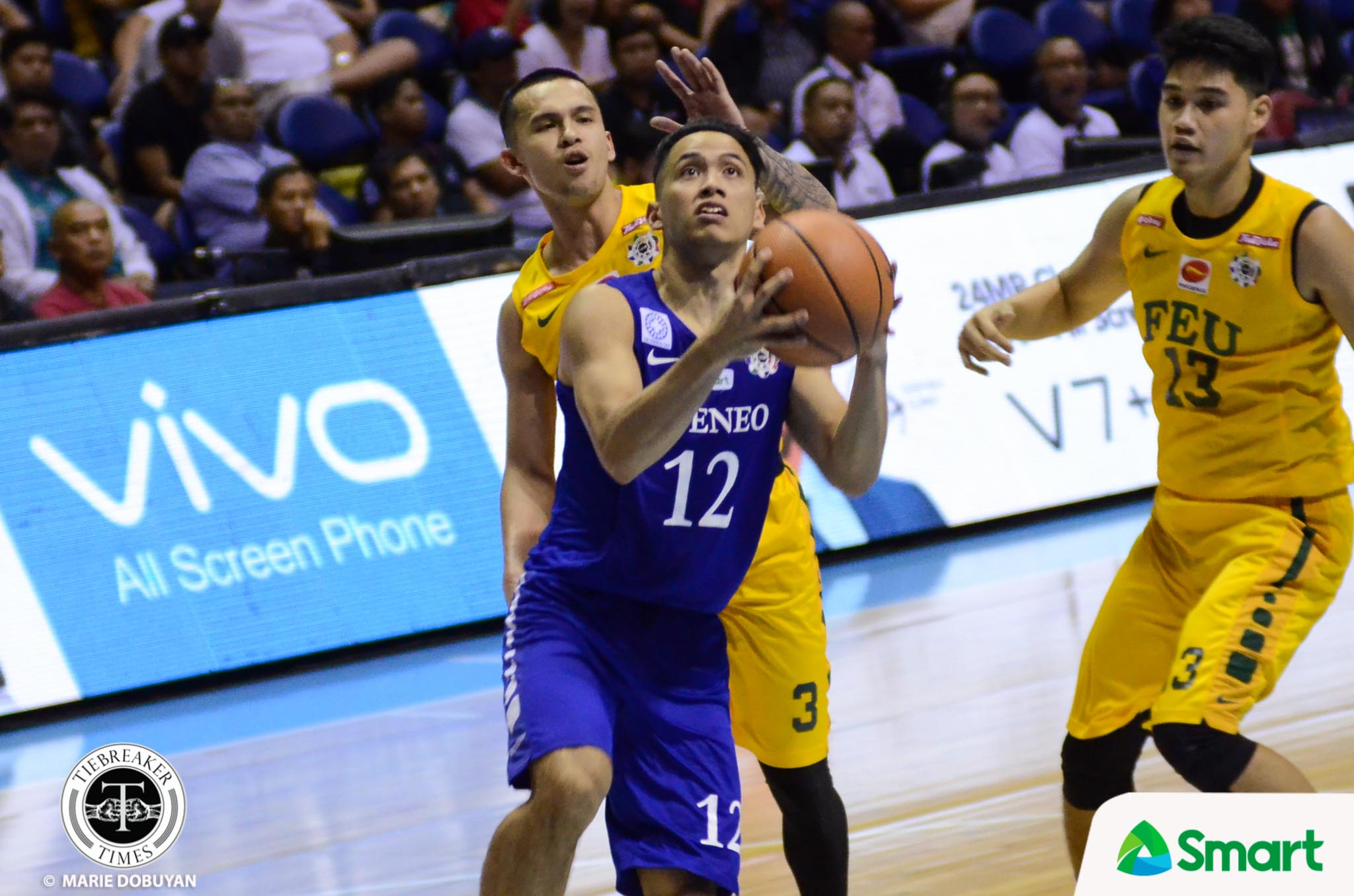 Philippine Sports News - Tiebreaker Times Ateneo locks FEU down late to clinch Final Four spot ADMU Basketball FEU News UAAP  UAAP Season 80 Men's Basketball UAAP Season 80 Tab Baldwin Ron Dennison Raffy Verano Olsen Racela Matt Nieto FEU Men's Basketball Ateneo Men's Basketball Arvin Tolentino