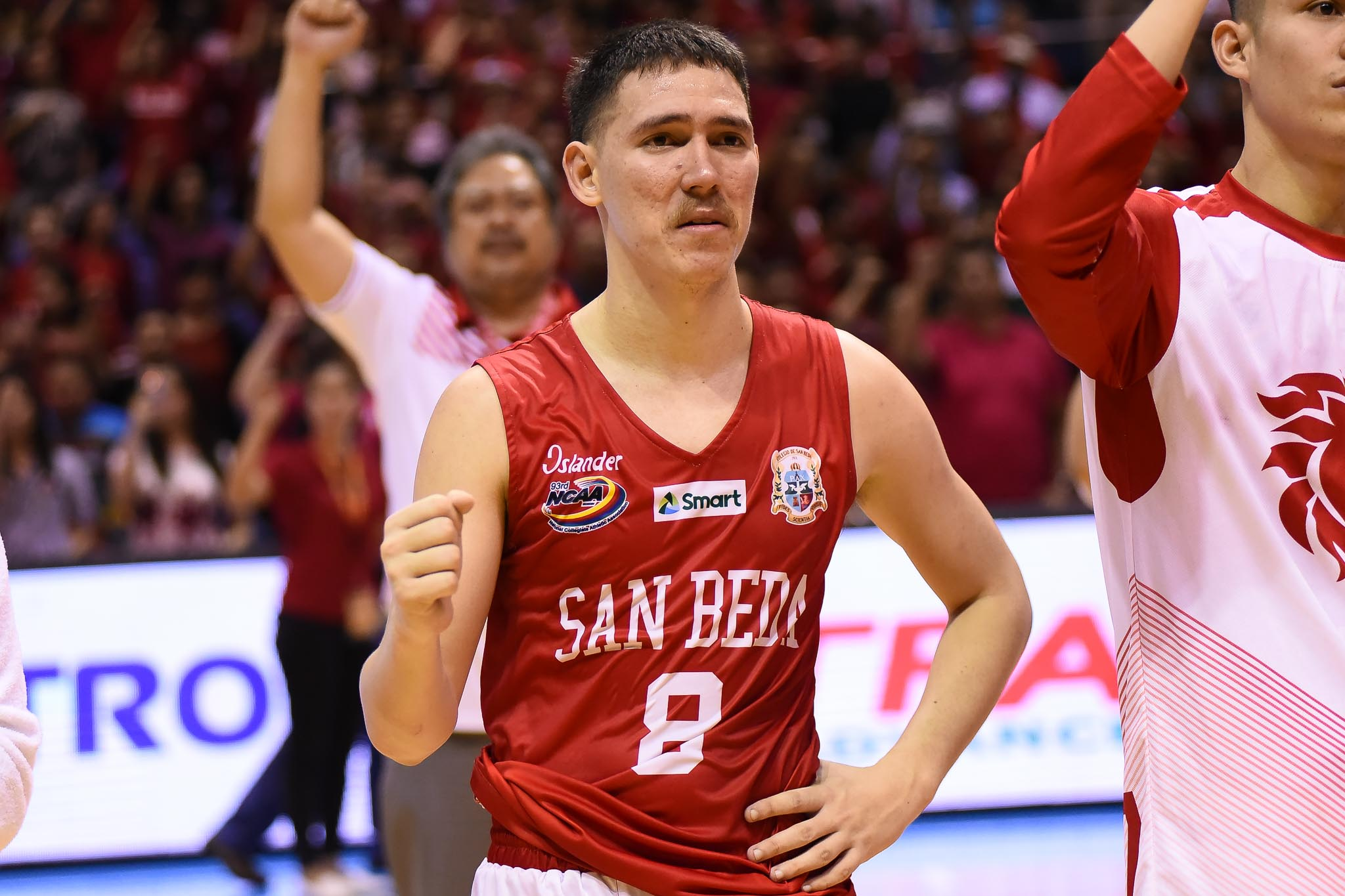 Philippine Sports News - Tiebreaker Times Exasperated Robert Bolick breathes sigh of relief after Game 1 win Basketball NCAA News SBC  San Beda Seniors Basketball Robert Bolick NCAA Season 93 Seniors Basketball NCAA Season 93 Boyet Fernandez