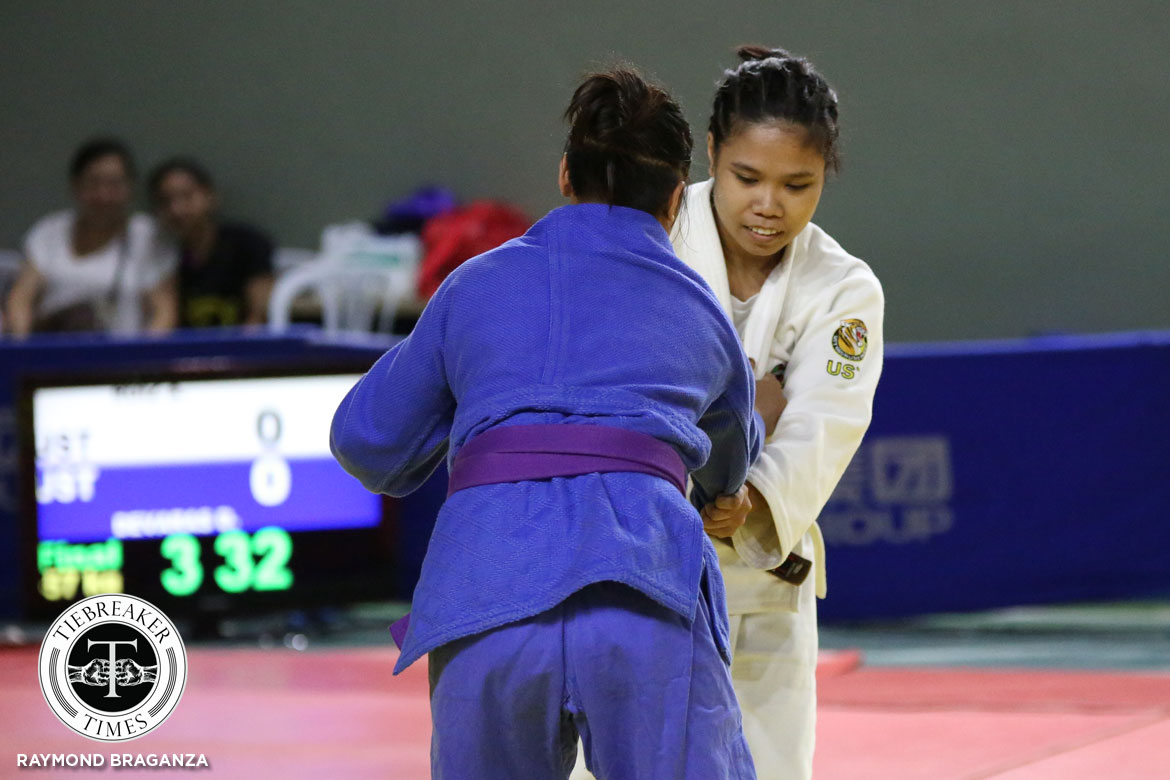 Tiebreaker Times UST holds slim edge over UE as Khrizzie Pabulayan, Almira Ruiz pocket gold ADMU DLSU Judo News UAAP UE UP UST  UST Women's Judo UP Women's Judo UE Women's Judo UAAP Season 80 Women's Judo UAAP Season 80 Khrizzie Pabulayan Jealane Lopez Gege Arce DLSU Women's Judo Claudine Nargatan Ateneo Women's Judo Almira Ruiz