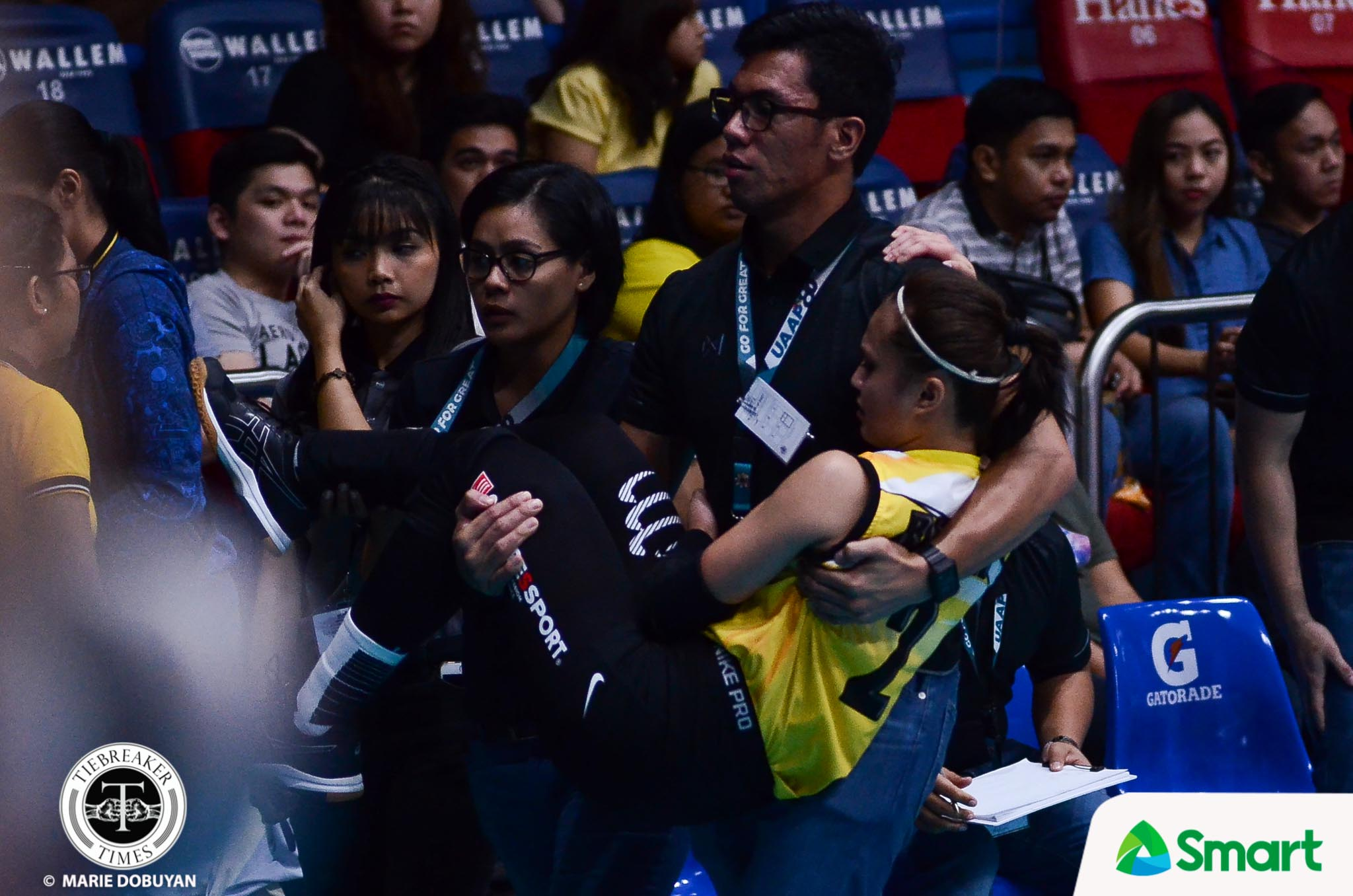 Tiebreaker Times Rica Rivera carried off the court after apparent knee injury News UAAP UST Volleyball  UST Women's Volleyball UAAP Season 80 Women's Volleyball UAAP Season 80 Rica Rivera