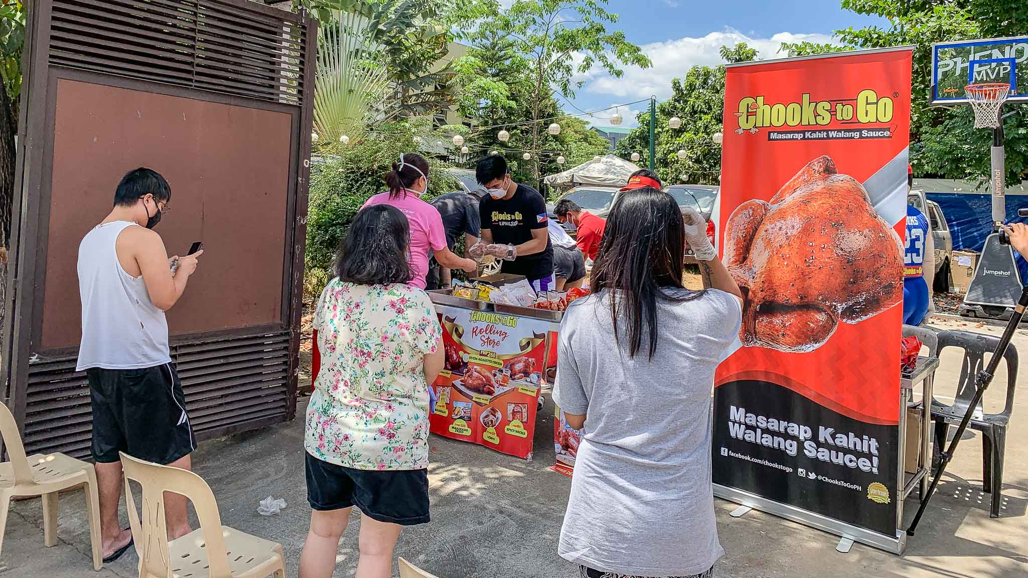 Kiefer-Ravena-Rolling-Store-6496 Kiefer Ravena, Alyssa Valdez set up Chooks rolling store for village Basketball News PBA  - philippine sports news