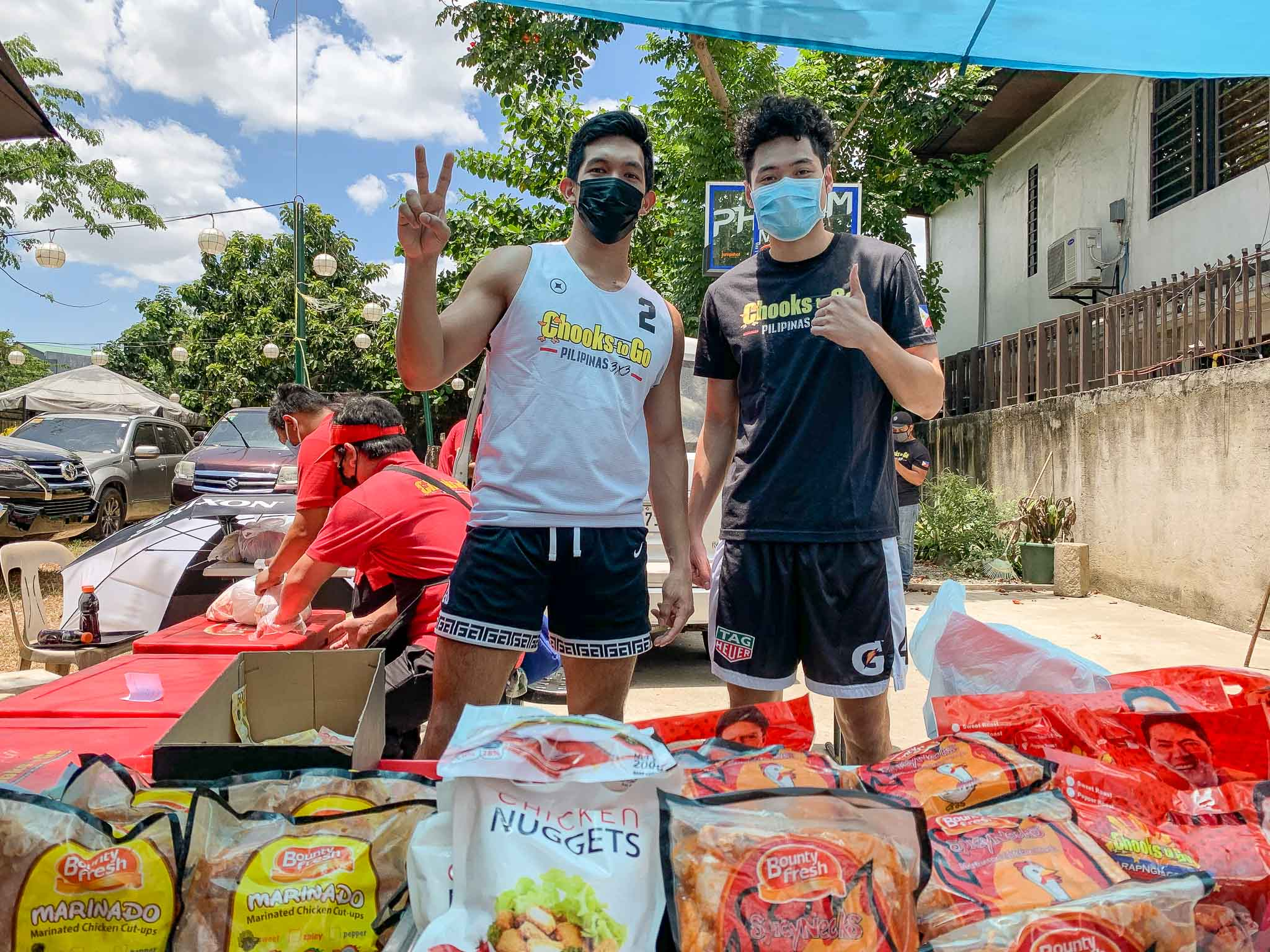 Kiefer-Ravena-Rolling-Store-6539 Kiefer Ravena, Alyssa Valdez set up Chooks rolling store for village Basketball News PBA  - philippine sports news