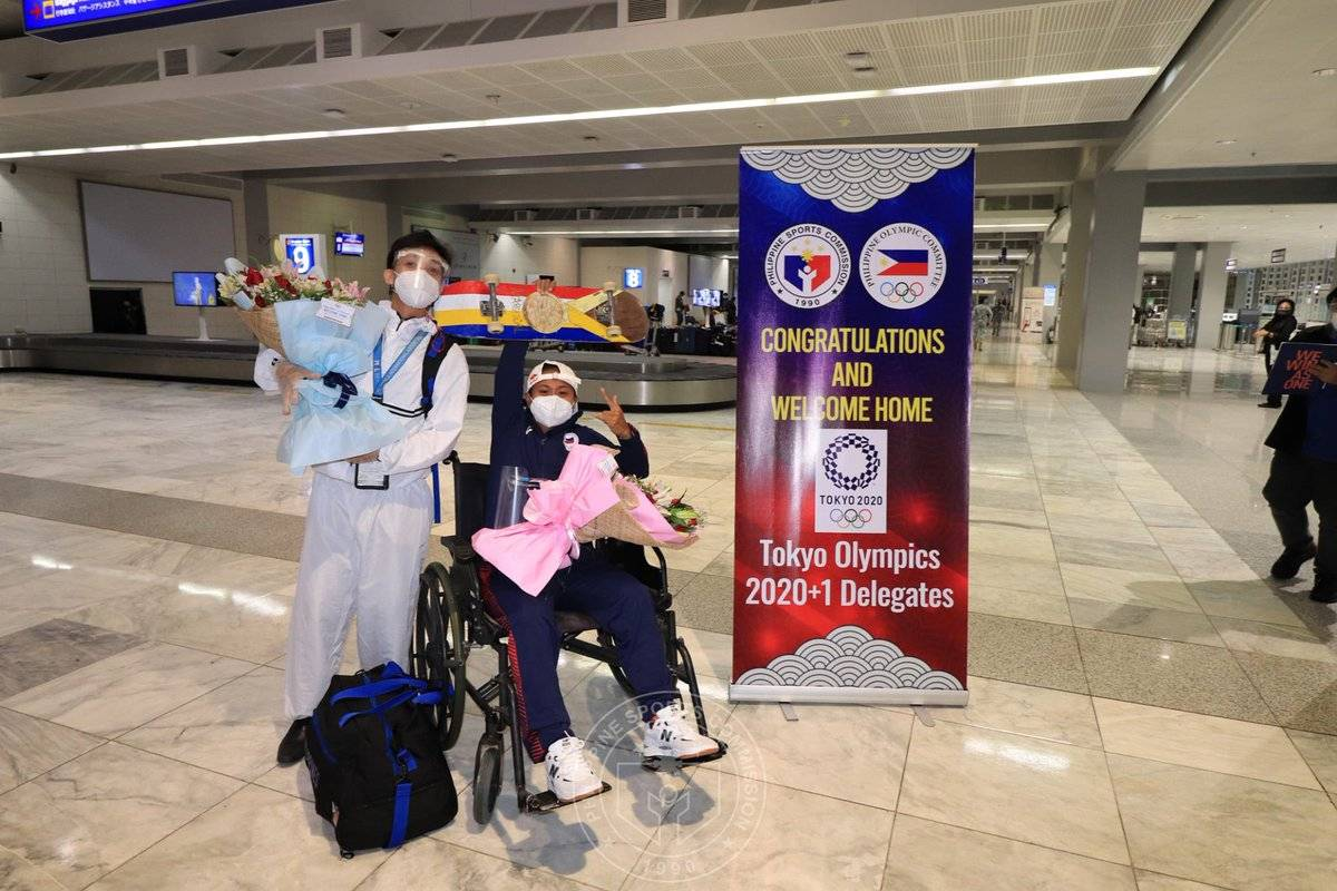 2020-tokyo-olympics-arrival-margie-didal Hidilyn Diaz arrives to hero's welcome 2020 Tokyo Olympics News Skateboarding Weightlifting  - philippine sports news
