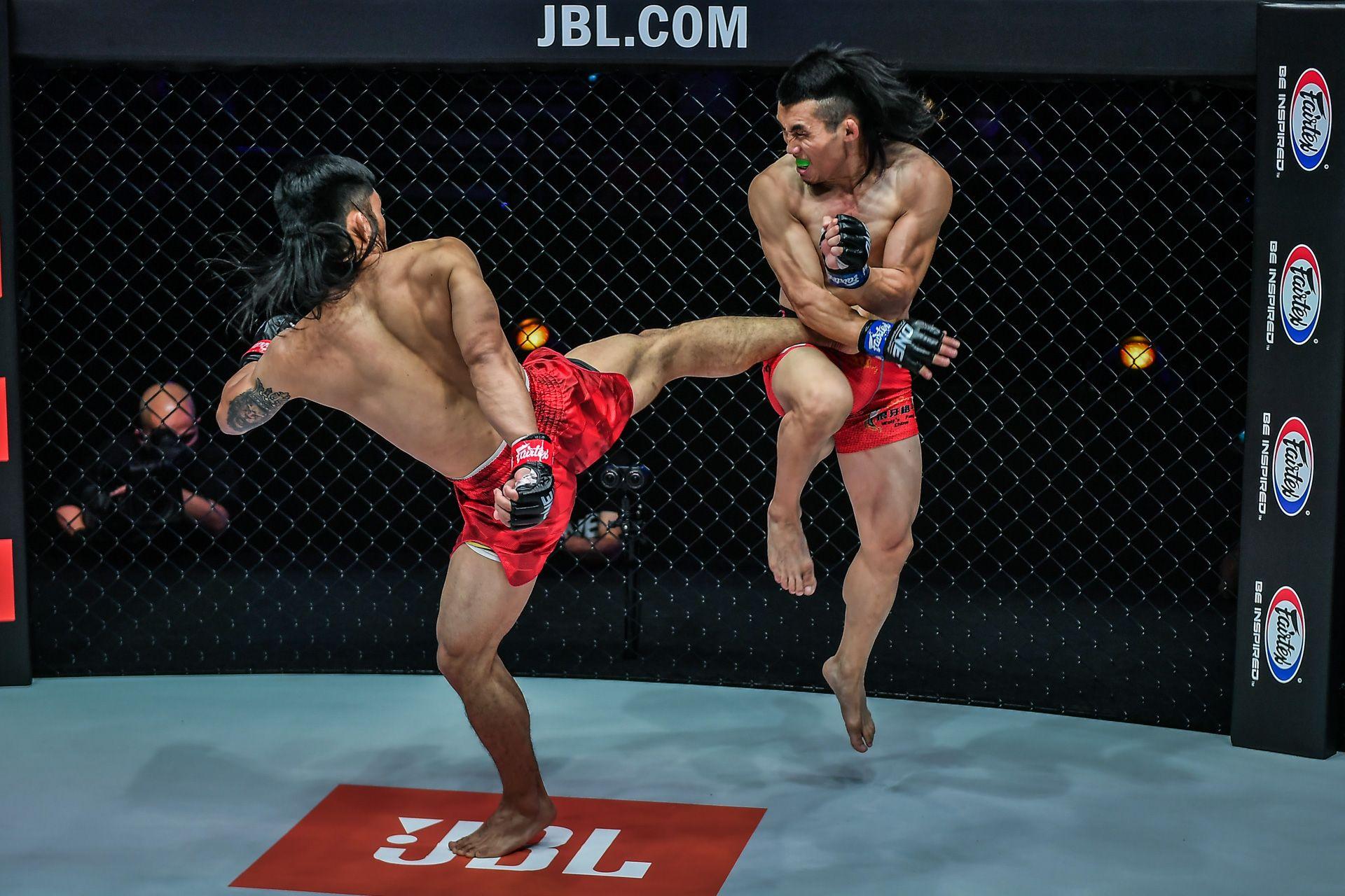 ONE-Revolution-Adiwang-body-kick-to-Hexigetu ONE: Revolution: Lito Adiwang shows no rust, stops Hexigetu's streak Mixed Martial Arts News ONE Championship  - philippine sports news